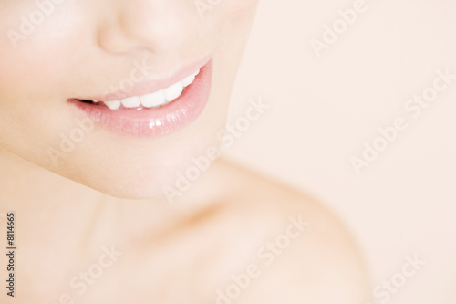 Close-up of young woman's smile