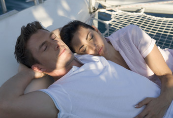 A couple relaxing on a catamaran