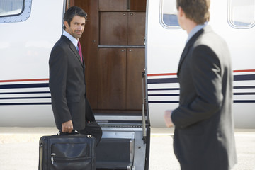A businessman boarding a plane