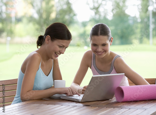 Two young with a laptop after a yoga class