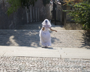A bride walking down steps