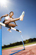 Female hurdler in action