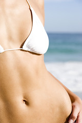 A young woman's torso in bikini top