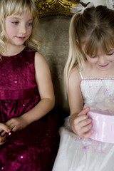 Little girls sharing birthday presents