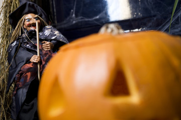 Hallowe'en decorations - puppet witch with wand and orange pumpkin