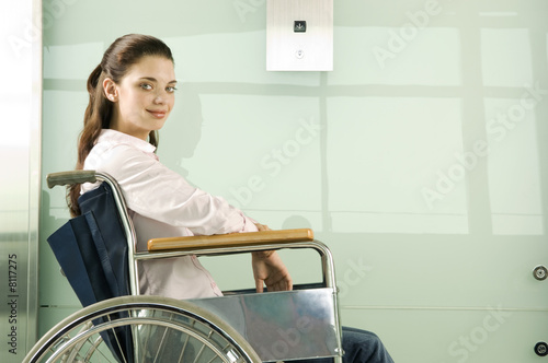 A woman in a wheelchair waiting for the lift