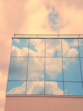 reflected sky on a building poster