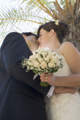 A bride and groom kissing