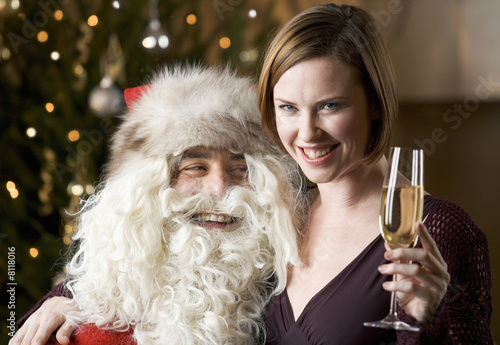 Father Christmas/Santa Claus and a woman drinking champagne