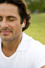 Cropped portrait man with earphones