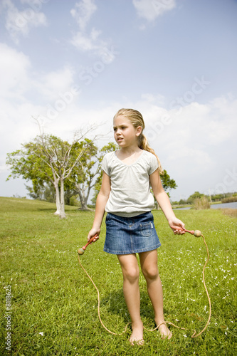little girl playing with skipping rope