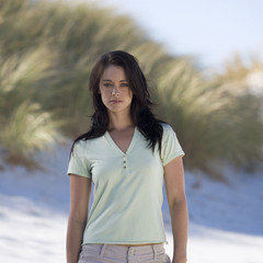 A young woman standing on a beach