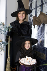 Mother and daughter dressed up as witches for Halloween
