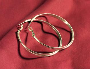 Silver Earings on Red Blanket