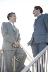 Two businessman talking