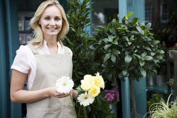 Woman florist or gardener  holding some white flowers
