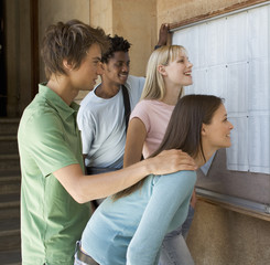 A group of students checking their exam results