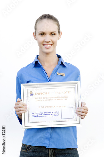 Portrait of a supermarket assistant with an Employee of the Month certificate