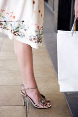 Woman wearing a skirt and high heels, close up of legs