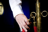 Cinema or theatre usher's hand holding red cordon