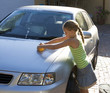Young girl washing a car