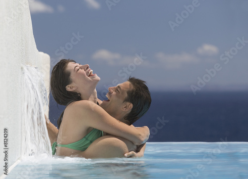 A couple embracing in a pool