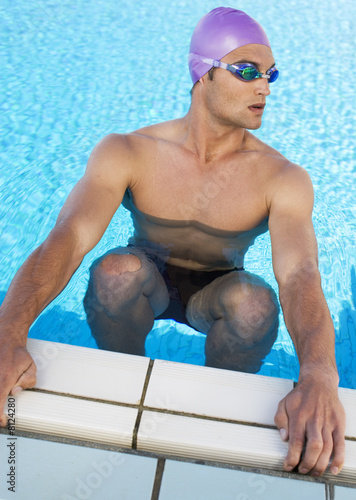 A young man in a swimming pool
