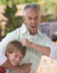A father with his young son fooling about