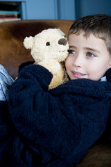 portrait little boy with teddy bear