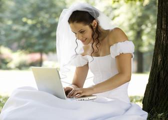 A bride using a laptop