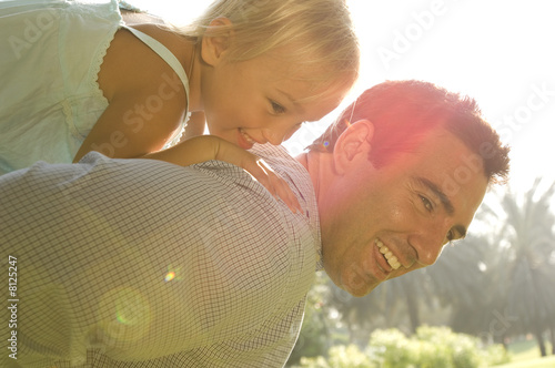 A young girl with her father