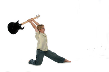 boy with electric guitar raised up over his head