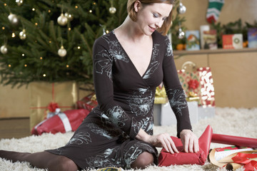 A woman wrapping Christmas presents