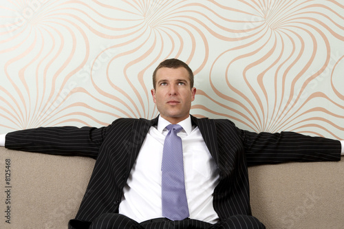 Businessman sitting on sofa