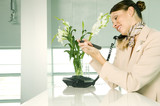A receptionist talking on the telephone