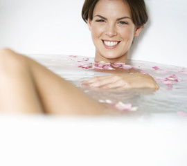 A young woman in a spa bath