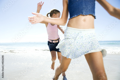 Two young girls having fun on the beach