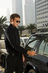 A wealthy man locking his car