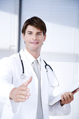 Male doctor with his hand out for  handshake