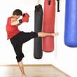 A young man kick boxing