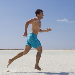 A man running on a beach