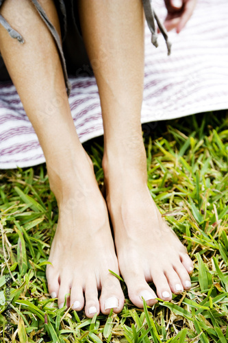 woman's bare feet on the grass