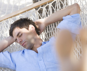 A man sleeping in a hammock
