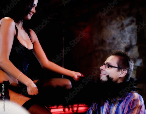 An erotic dancer teasing a client