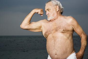 Portrait of a senior man flexing his biceps