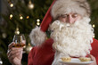 Father Christmas/Santa Claus eating mince pies with a glass of brandy