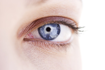 A woman's blue eye with mascara