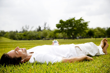 man lying on the grass relaxing
