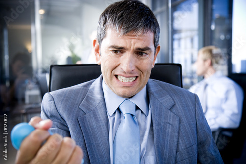 Businessman squeezing a stress toy
