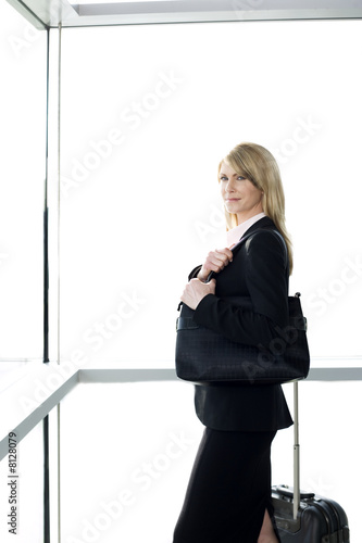 Businesswoman traveling, waiting at airport or station